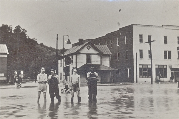 A rare light moment during the storied 1937 flood that put a hurt on Bassett, Va. The creation of the Philpott Dam in the '50s, a $13 million project that finally kept the Smith River silt out of factory workers' homes. | Photo courtesy of Bassett Historical Center