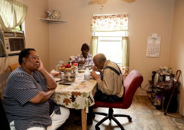 Janet Johnson, 70, feeds her parents breakfast most mornings at their Franklin County home in Truevine. Roanoke Times photo by Stephanie Klein-Davis